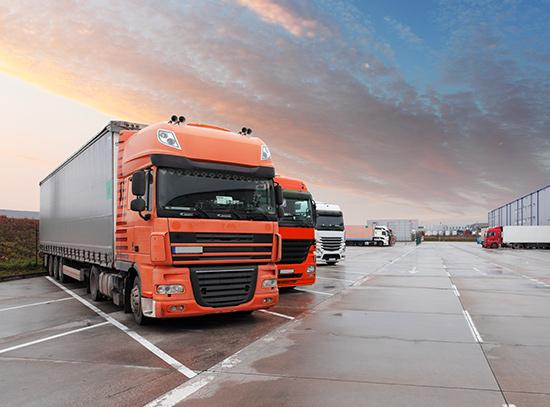 Loans against trucks - image of trucks parked in a truck yard.